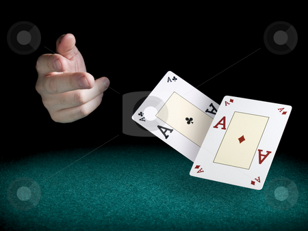 Flying aces stock photo, A man's hand throwing two aces over a green felt. by Ignacio Gonzalez Prado