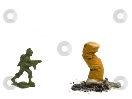Kill it! stock photo, A cigarette butt been killed by a soldier. by Ignacio Gonzalez Prado