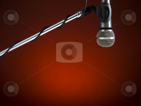 Radio mic stock photo, A microphone on a boom over a red background. by Ignacio Gonzalez Prado