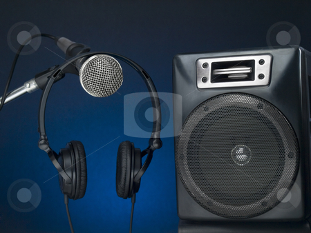 Let's rock! stock photo, Professional microphone, headphone and speaker with a defused blue background. by Ignacio Gonzalez Prado