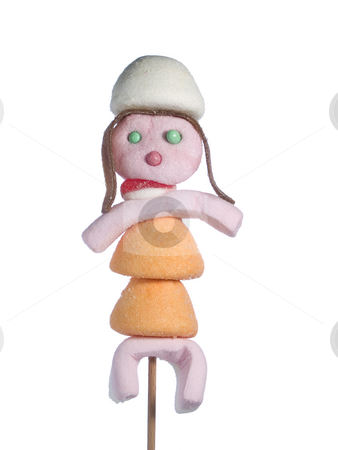 Candy people stock photo, A female figurin made out of candies on a stik over a white background. by Ignacio Gonzalez Prado