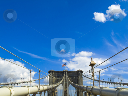 Brooklyn bridge stock photo, A view of the Brooklyn bridge with a blue sky on the background. by Ignacio Gonzalez Prado