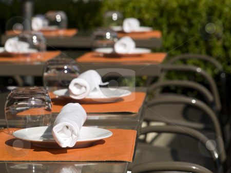 Summer lunch or brunch stock photo, Restaurant set up tables on a sunny terrace. by Ignacio Gonzalez Prado