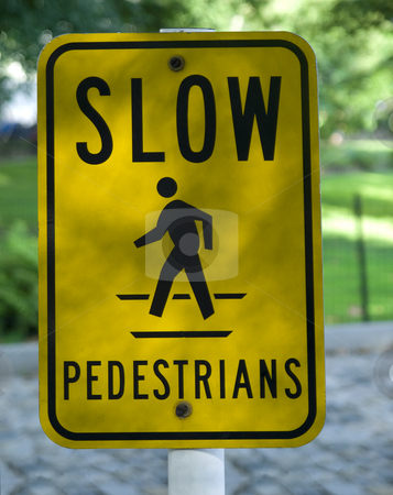 Slow pedestrians stock photo, A Slow Pedestrian sign in a sidewalk park. by Ignacio Gonzalez Prado