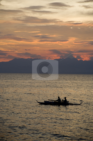 Sunset Cebu Fisherman stock photo, Local Philipino fisherman return to port after a long day. by A Cotton Photo