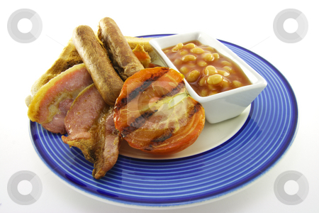 Breakfast and Beans stock photo, Slices of crispy pork bacon with half a grilled tomato two thin pork sausages and a small dish of baked beans on a blue round plate with a white background by Keith Wilson
