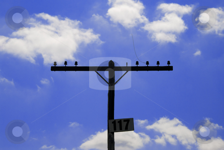 New Wireless Era stock photo, Very old vintage telephone pole with crossbeam and insulators. by Charles Buegeler