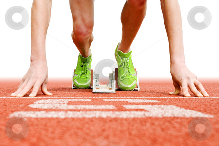 At the Starting blocks stock photo, Athlete in the starting blocks, ready to go by Corepics VOF