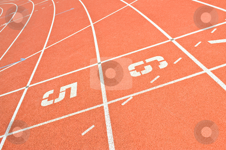 Running track lines stock photo, Lines and starting grid on an oval running track by Corepics VOF