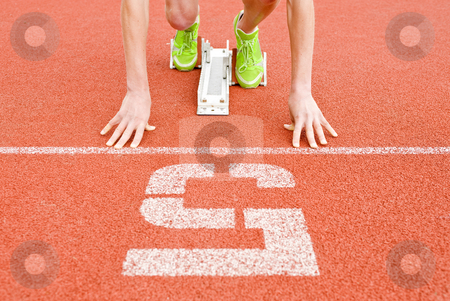 Starting line stock photo, Athlete at the starting line in lane five, ready to go by Corepics VOF
