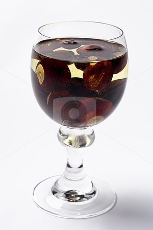 Bubbly nut wine stock photo, Glass of bubbly white wine containing chestnuts by Yann Poirier