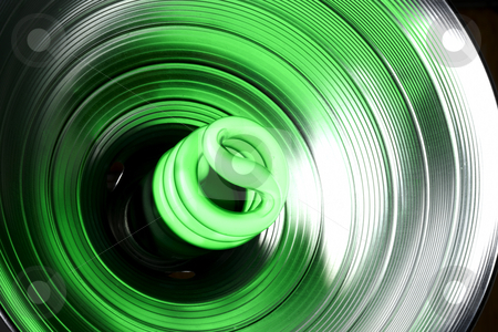 Goin' Green stock photo, Green compact fluorescent bulb lights up in a reflector by James Barber