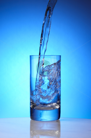 Pure water stock photo, Pure spring water pours into drinking glass by James Barber