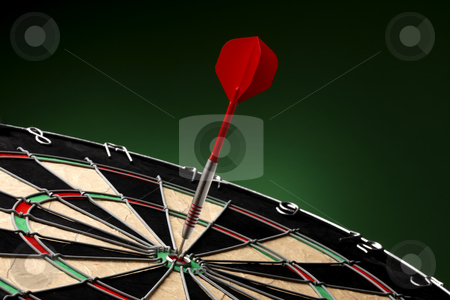 Bullseye! stock photo, Dart sticks to bullseye on a dart board by James Barber
