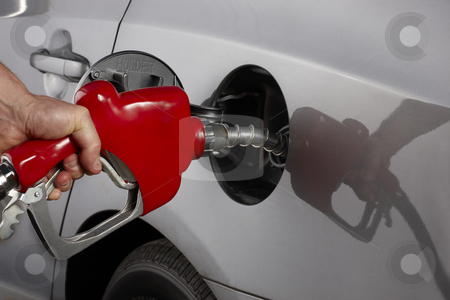 Fill 'er up! stock photo, Gas attendant fills car with gasoline by James Barber
