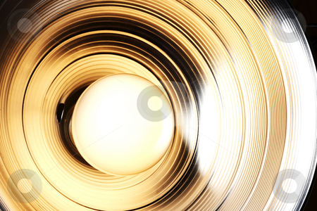 Lights on! stock photo, Incandescent light bulb aglow in a reflector by James Barber