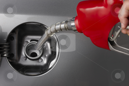 Fill up stock photo, Gas attendant fills car with gasoline by James Barber
