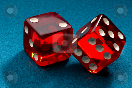 Rollin' Red Dice stock photo, A pair of red transparent dice shot on blue felt by James Barber