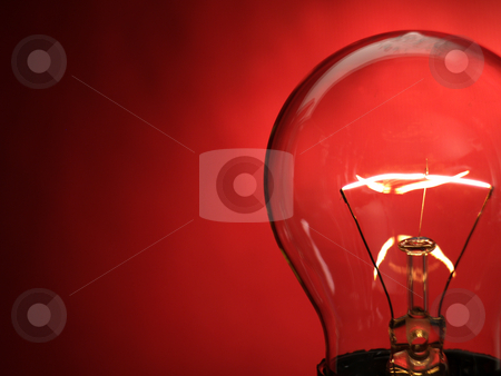 Bulb light stock photo, A bulb light on red background by Ignacio Gonzalez Prado