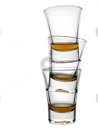 Three shots of whiskey stock photo, A pile of three almost empty shots of whiskey on white background. by Ignacio Gonzalez Prado