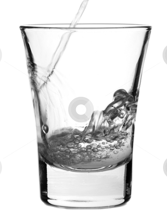 Shot of vodka stock photo, Pouring a shot of vodka on white background. by Ignacio Gonzalez Prado