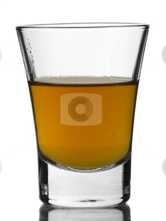 Shot of whisky stock photo, A shot of whisky on white background. by Ignacio Gonzalez Prado