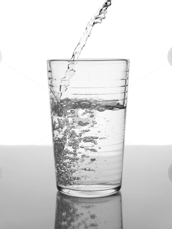 Glass of water stock photo, Water being poured in a glass. by Ignacio Gonzalez Prado