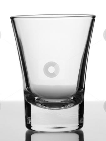 Empty glass stock photo, An empty shot glass on white background. by Ignacio Gonzalez Prado