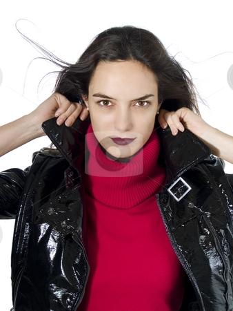 Sexy girl stock photo, Portrait of a beautiful model holding her black leather jacket over white background. by Ignacio Gonzalez Prado
