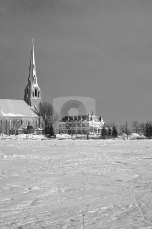 Church by the lake stock photo, Winter landscape of a church by the lake by Yann Poirier