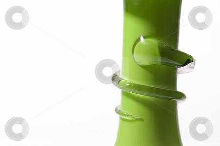 Snake on green stem stock photo, Decorative glass snake on the stem of a green vase by Yann Poirier