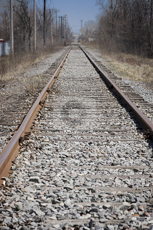 Rail road track stock photo, Rail road track in spring, right after the snow finish to thaw by Yann Poirier