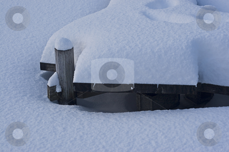 Dock covered with snow stock photo, Wooden dock cover with snow by Yann Poirier
