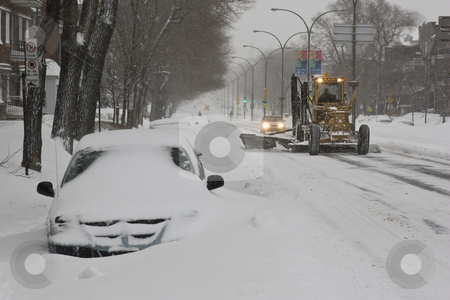 Snow removal stock photo, Plow removing snow in the middle of a snow storm by Yann Poirier