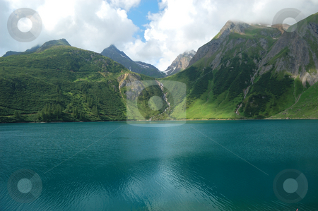 Alpine lake stock photo, Panoramic view of an alpine lake (Morasco lake, Italy) by ALESSANDRO TERMIGNONE
