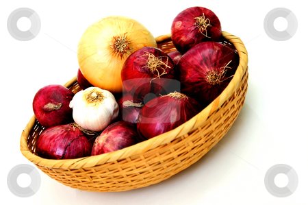 Basket Of Onions stock photo, Red and yellow onions in a wicker basket with a single bulb of garlic by Lynn Bendickson