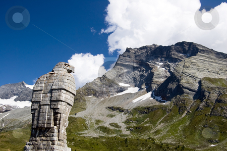 Mountain eagle statue stock photo, A statue of an eagle dominates a mountain background by Roberto Marinello