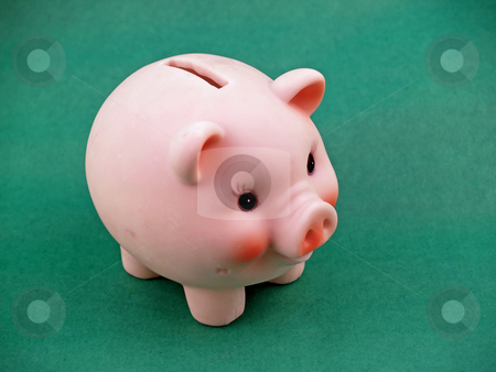 Piggy bank stock photo, Piggy bank on green for easy isolation by Cora Reed