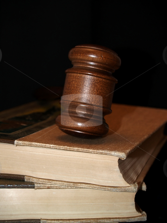 Gavel and law books stock photo, A couple of law books with a gavel on top.  law concept by Cora Reed