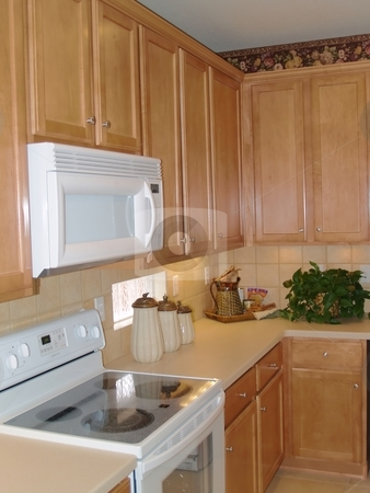 Clean new kitchen stock photo, New kitchen with oak cabinets and white appliances by Cora Reed