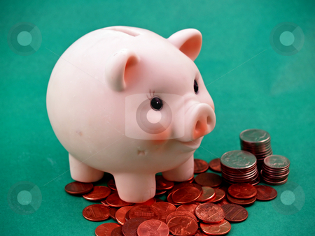 Piggy bank stock photo, Pink piggy bank on green for easy isolatoin by Cora Reed