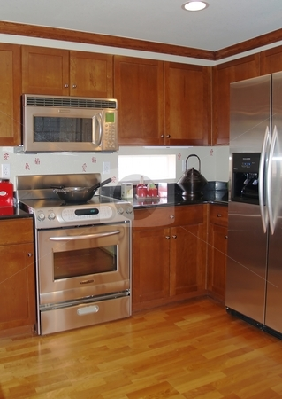 Open kitchen stock photo, Open kitchen with hard wood floors and stainless steal appliances by Cora Reed
