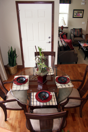 Dinning table stock photo, Dinning area adjacent to the living room by Cora Reed