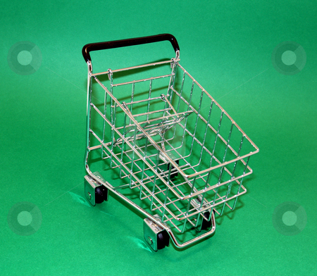 Shopping cart stock photo, A little shopping cart on green for easy isolation by Cora Reed