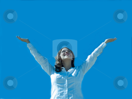 Expression of joy. stock photo, A hispanic woman with arms extended to the sky. by Cora Reed