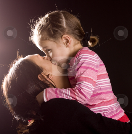 Mum and daughter stock photo, Daughter kissing her mother on the cheek by Jandrie Lombard