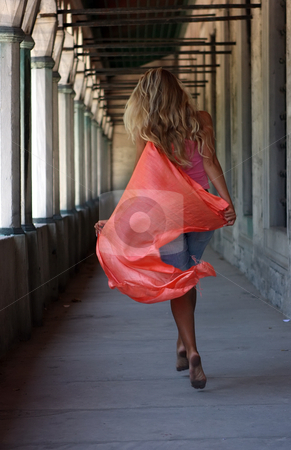 Blonde with red shawl stock photo, Blonde going through the corridor with orange shawl by Dmitry Rostovtsev