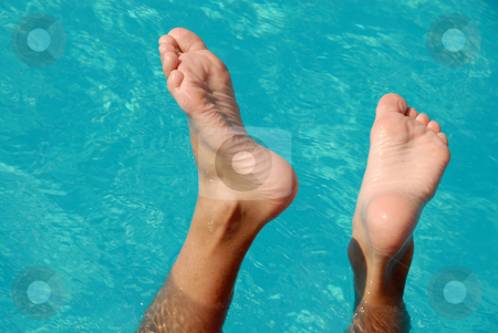 Feet in swimming pool stock photo, Wet boy feet over blue transparent pool water by Julija Sapic