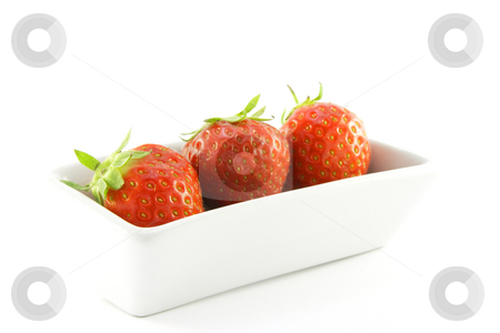 Strawberries in a Dish stock photo, Juicy ripe red strawberries in a small white dish on a white background by Keith Wilson