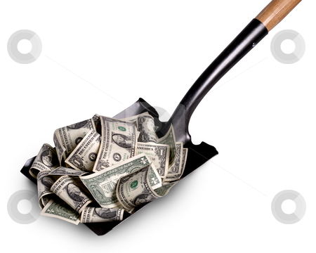 Shoveling it in stock photo, Shovel lifts dollar bills of a white background by James Barber